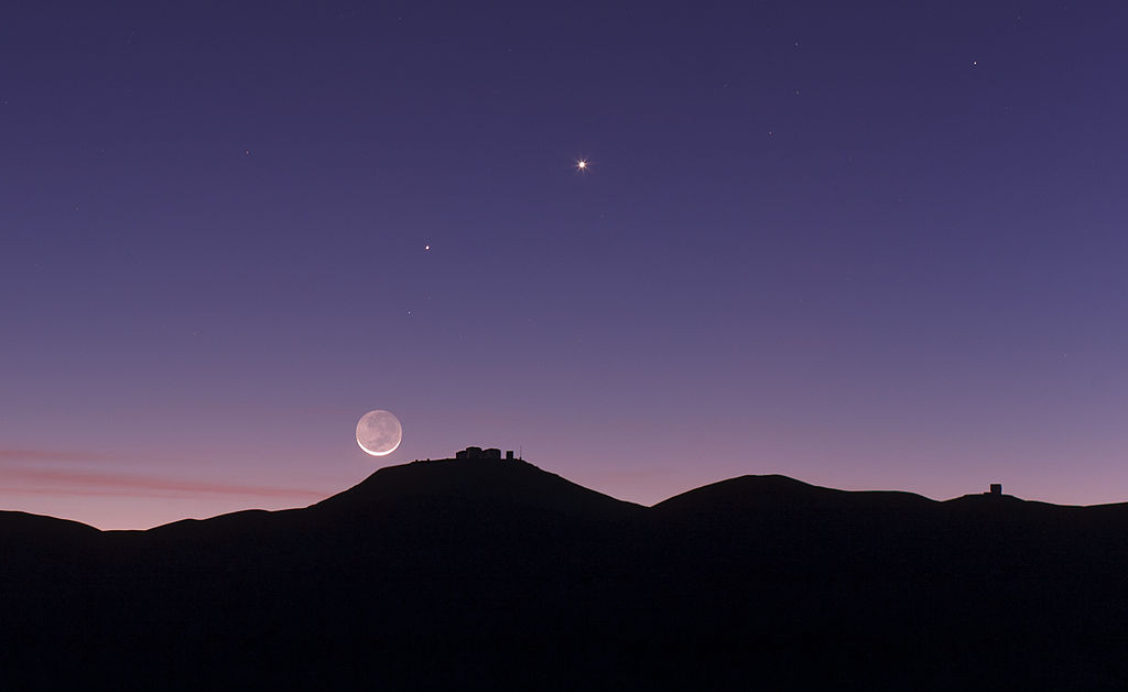 Crescent Moon with Earthshine setting over ESO's Paranal Observatory in Chile (credit:- ESO)