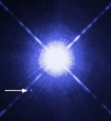 The Sirius system. Sirius A is the brightest star in the night-time sky, Sirius B - pointed to by the arrow - is a white dwarf (credit:- NASA)