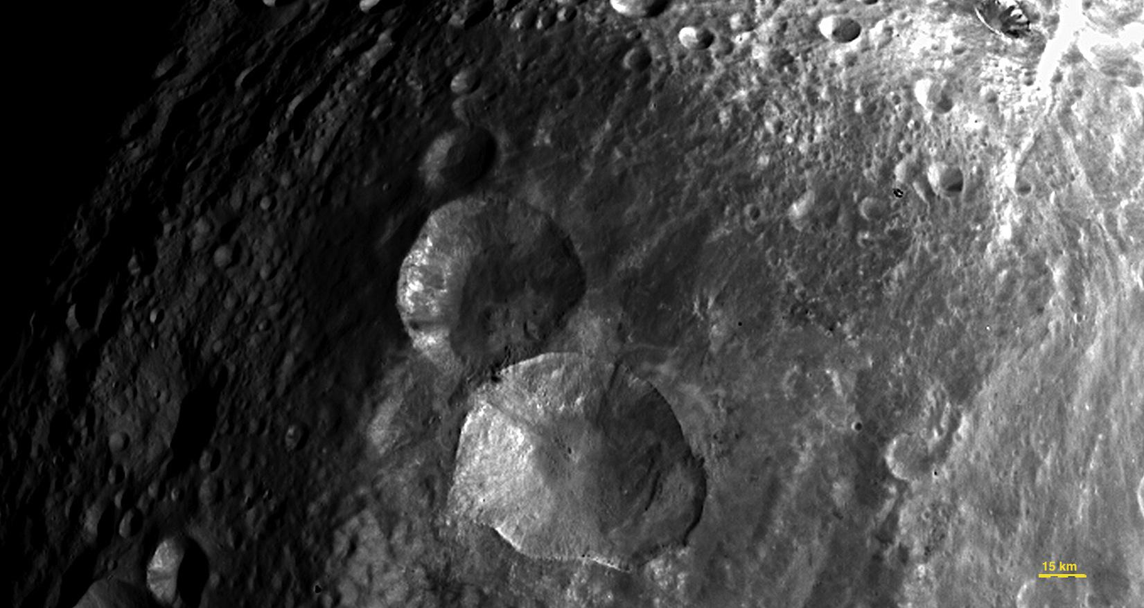 Dawn image of Snowman Craters on Vesta from 5200km on 24th July 2011 (NASA/JPL Caltech/UCLA/MPS/DLR/IDA)
