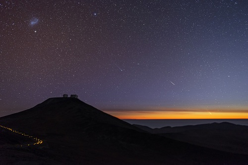 Two comets and a shooting star at sunset over the Paranal Observatory, Chile. Comet PanSTARRS is seen at the lower right, Comet Lemmon towards the middle of the image with the shooting star positioned between the two. (ESO/G. Brammer)