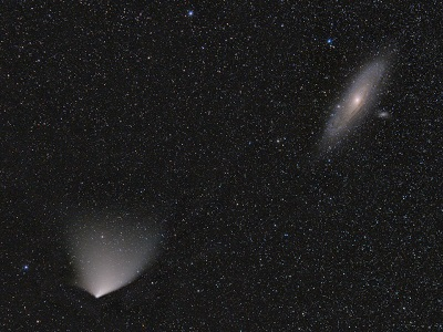 Comet PanSTARRS passing by M31 on March 30, 2013 (Image credit - Pavel Smilyk)
